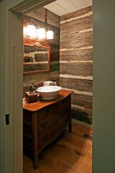 rustic bathroom by Clark & Zook Architects, LLC