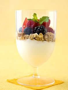 For this sweet snack, layer yogurt, granola, almonds and honey and top with fresh berries. It's also fantastic for dessert.
