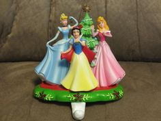 Cinderella is wearing a crown. White cuff decorated with crown. A great Christmas gift or addition to your Disney Christmas decorations. Christmas Stocking Holders, Great Christmas Gifts, Christmas Stockings, Holiday, Aurora Snow, Disney Christmas Decorations, Peanuts Christmas, Grinch, Cinderella