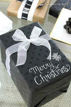 Use a chalk pen on black wrapping paper to write messages and gift tags - love this Christmas wrapping idea!