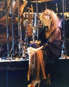 """Stevie sitting onstage in 1979. """