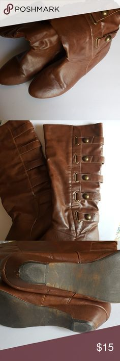 Madden girl boots Slip on brown boots...no size but I'd say they're a 9. Theure 11 inches from the back of the heel to toe, but the toe is small and tight on my 9.5 foot. Will fit wide calves. Madden Girl Shoes