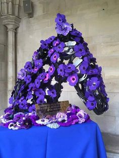 Beautiful A beautiful sculpture of purple poppies honouring the animals killed i