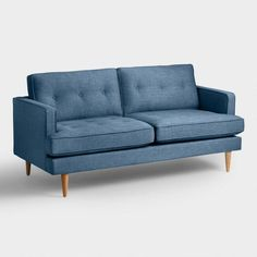 A clean silhouette, tufted detailing and tapered Danish-inspired legs give our sofa a wealth of mid-century style.
