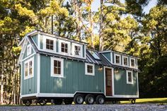 This is a custom Ridgewood Model tiny house on wheels by Timbercraft Tiny Homes. The Ridgewood Tiny House by Timbercraft Tiny Homes Tiny House Swoon, Tiny House Living, Tiny House Plans, Tiny House On Wheels, Tiny House Design, Tiny Houses For Sale, Little Houses, Small Houses, Timbercraft Tiny Homes