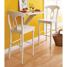 Kitchen Barstools. A great way to use a tiny space. This might be fun in a kitchen for a homework space while I cook dinner.