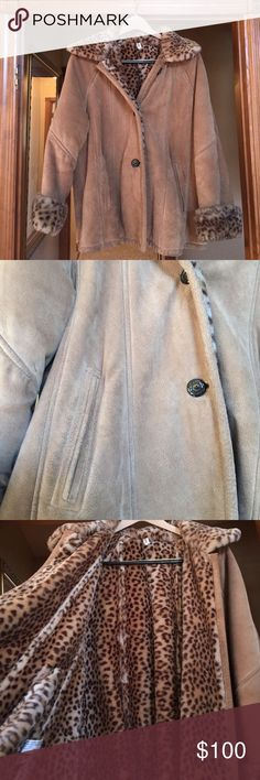 Genuine Leather Cheetah Jacket Really nice leather jacket with leopard interior. Leopard is faux but the leather is genuine. Tag says Medium but listed as a Large because it runs large. Warm, heavy coat. Three buttons down. Coat has minor dirt as shown in last photo. Interior lining is 100% modacrylic J. Percy Jackets & Coats