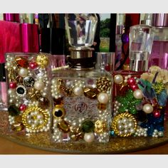 """Some empty perfume bottles i transformed into fabulous decor for my vanity table ~ just a few """"pretties"""" and a glue gun ; Crafts To Do, Diy Craft Projects, Diy Crafts, Empty Perfume Bottles, Glass Bottles, Mosaic Bottles, Chanel Perfume, Wraps, Perfume Collection"""