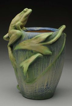 "Paris Expo 1900 Amphora Ceramic Frog Vase with Blue Green Pastel Glazes. The applied Frog and Leaves are highly Stylized. Impressed Amphora, Paris Expo 1900 mark, Turn and 4099, 1900, Austria.  (Mint). Size 10"" T."