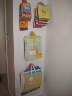 craft room organization: Gift bags on hooks in craft corner  www.alejandra.tv