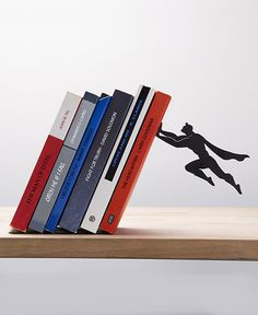 "Clever superhero bookend ""saves"" books from falling. #design"