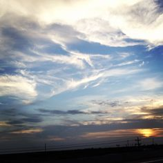 I took this photo driving back from Brownsville Texas.  Loved the feathery clouds along with the sunset.  Rio Grande Valley.