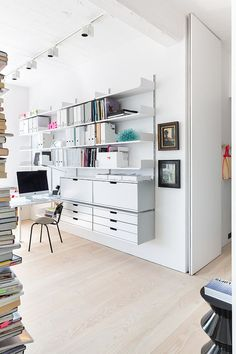 Sliding doors separate the home office from the living area [Design: Cloud Studios Ltd]