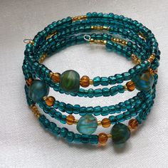 Aquamarine Beaded Memory Wire Bracelet with Amber Accents by ThreeBredEwes on Etsy