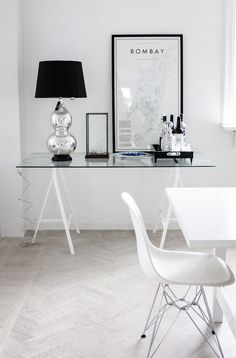 monochrome scheme with #eames chair and glass table lamp