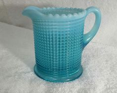 This is a very, very rare Albany Ribbed Spiral Blue Opalescent Creamer. To me, the Ribbed Spiral pattern is the prettiest pattern ever made by Albany. Its gorgeous when you put together a water/table/berry set with s/p shakers and cups/saucers. This opalescent Creamer that is over 100  years old. I have had this creamer in my collection for over 20  years and has no chips, no cracks, no dents, etc except maybe a very small, if any, fly ash while being made over 100  years ...