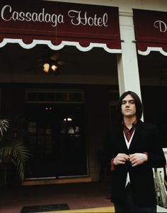 Conor Oberst in front of the Cassadaga Hotel