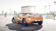 tesla roadster background wallpaper free, 2560x1440 (517 kB)
