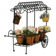 Byers' Choice Flower Cart 2015   We love to include accessories to put the finishing touches on our Caroler displays. The Daffodil Fence and Metal Flower Cart will work beautifully into your Spring decor.