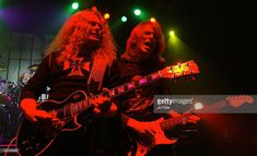 Vocalist Scott Gorham and original guitarist John Sykes of rock band Thin Lizzy performs on stage during London date of their UK tour, at the Shepherds Bush Empire on February 4, 2005 in London.