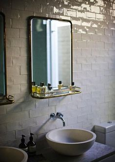 Subway Tile. Small bathroom mirror. i like the faucet in the wall idea with bowl sink