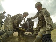Artillerymen of 3rd Battalion,319th Airborne Field Artillery Regiment,1st Brigade Combat Team,82nd Airborne Division fire the M119A3 105mm lightweight howitzer. Ft Bragg,NC. April 2013(US Army photo)