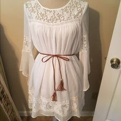 Sheer White Dress Sheer white dress with lace detail and braided brown belt. Worn a couple of times. Size L from Filly Flair. Filly Flair Dresses
