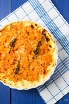 Butternut Dauphinoise comprises thin layers of butternut squash drowned in cream and topped with cheese. Vegetarian food doesn't get better than this!