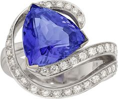 Tanzanite, Diamond, White Gold Ring The ring features a modified triangle-shaped tanzanite measuring 12.15 x 12.00 x 7.32 mm and weighing approximately 6.35 carats, enhanced by full-cut diamonds weighing a total of approximately 0.65 carat, set in 18k white gold. Gross weight 10.90 grams. Size: 6-3/4 (sizeable)