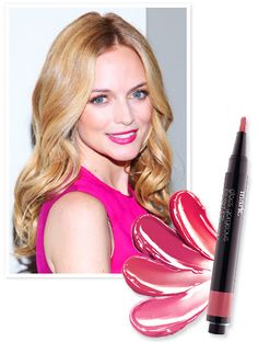 "Heather Graham matched her lip color to her raspberry Burberry shift dress at last night's Cambodian Children's Fund fundraiser in New York City. ""My makeup artist gave this to me, it's mark,"" she said, taking a lip pencil from her clutch. While Graham's exact shade is yet-to-be-released, the mark team directed us to their Gorgeous Gloss Stay On Lipstain in Vibe ($11 at meetmark.com), which packs the same color punch in a glossy finish."
