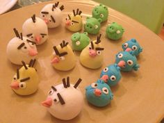 Angry birds cake toppers. Fondant icing, supermarket food colouring, licorice & toothpicks for holes. Eye dots are little sticks of licorice.