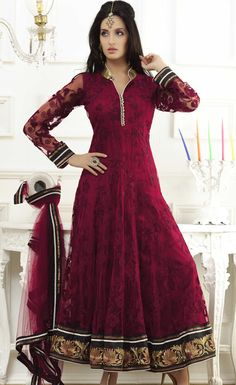 Look simple and beautiful by wearing a nice attire. A woman can enhance her beauty by wearing a simple salwar suit.