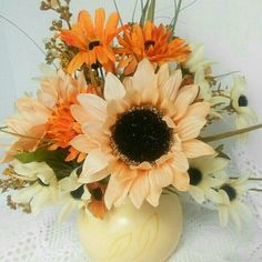 Cute yellow ceramic vase filled with sunflowers and other fall flowers, nice arrangement for living room table or even your bedroom.  ReverenceByKarin.etsy.com has a variety of arrangements available.  Please stop by and check us out!