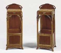 A PAIR OF ORMOLU-MOUNTED CARVED MAHOGANY NIGHT TABLES  LOUIS MAJORELLE, CIRCA 1905