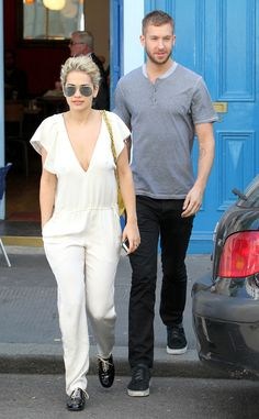 Calvin Harris stepped out in London with his gorgeous gal pal Rita Ora, who looked to die for in a white jumpsuit paired with oversized aviators!
