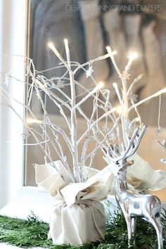 DIY Light Up Twig Trees, these are so cute and transition well from Christmas to winter! via @tarynatddd