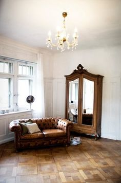 Vintage Chesterfield sofa and french antique cabinet