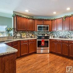 2014 Greater Toledo Parade of Homes – Eagle Creek Builders #paradecraze #paradeofhomes #EagleCreekBuilders #kitchen #woodfloor #cabinets #kitchencabinets #backsplash #stainless #oven #microwave #design #interiordesign #designer #interiordesigner #interiors #homedecor #homedesign #decor #toledo #toledohba #hbaofgreatertoledo