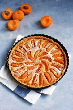 Made with seasonal stone fruits and a creamy almond custard, the Apricot Frangipane Tart is a French classic, all summer-round. In this home-made buttery crust, it's pure delight! In France,… Köstliche Desserts, Delicious Desserts, Dessert Recipes, Plated Desserts, Apricot Recipes, Almond Recipes, Almond Tart Recipe, Bakewell Tart, Tart Recipes