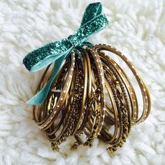 Set of Gold Bangles! Set of gold bangles! Each have their own intricacies. Contains 20 individual bangles. No flaws! Would recommend for a smaller wrist. Jewelry Bracelets