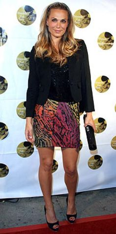 Look of the Day › September 25, 2009 WHAT SHE WORE A black blazer, sequin top and colorful animal-print skirt paired with black peep-toe heels and a Judith Leiber clutch WHERE Sixth Annual Friends of El Faro Benefit in Los Angeles