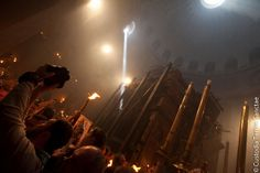 Holy Spirit's presence at the Miracle of Holy Fire at the Church of Holy Sepulchre in Jerusalem every year and for centuries