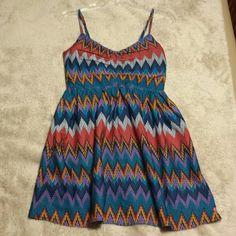 Roxy Dress Such a cute dress. Perfect for Summer.  Half zip back. Multi-colored chevron print. Roxy Dresses