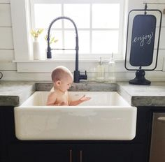 This is the most perfect thing ever...farmhouse sink + cute baby!