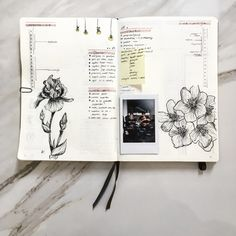 Bullet journal daily spread with flower drawings and polaroid pictures