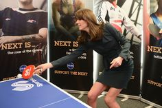 Catherine, Duchess of Cambridge plays table tennis as she and Prince William, Duke of Cambridge attend the ICAP charity day at ICAP on December 9, 2015 in London.