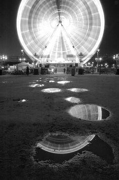 long exposure ferris wheel -reflections