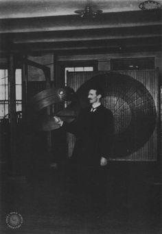 "Pictured here is Nikola Tesla during a demonstration of ""wireless"" transmission of electricity in the Houston Street laboratory in March 1899."
