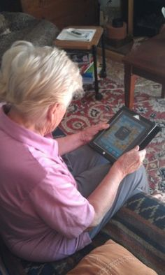 Playing games on an iPad is a fun way for the elderly to constantly be in touch and connect with family and friends.