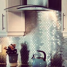 Tin Back splash on Property Brothers. So pretty but those of us that cook...the grease in there, yuck